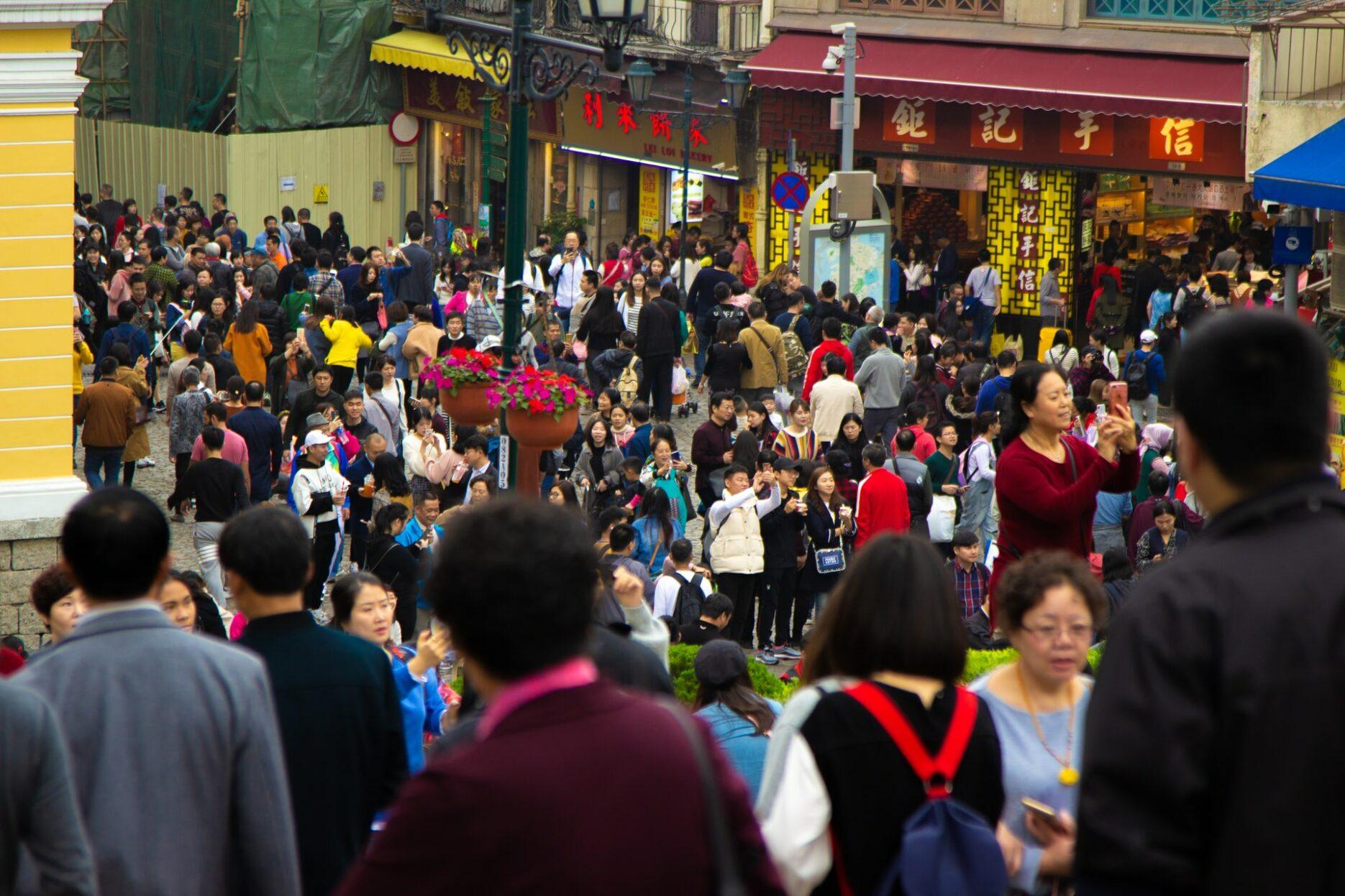 Menschen unter Chinas Wirtschaftspolitik